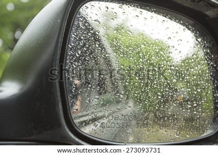 Rain drops on a truck side mirror