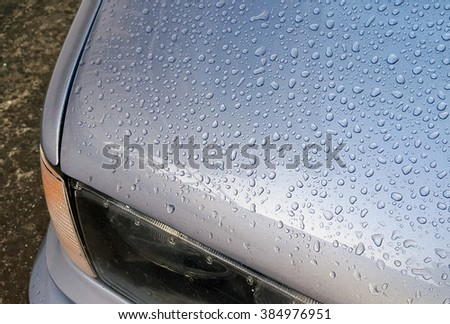 Rain drops on a waxed car hood
