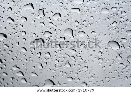 Rain drops on a window. - stock photo