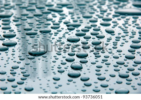 rain drops  on black car roof - stock photo