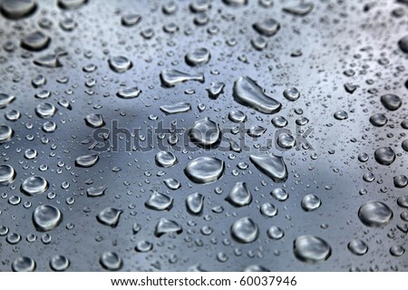 rain drops on car body, shallow focus - stock photo