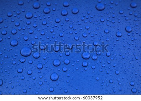 rain drops on car body, shallow focus