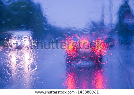 rain drops on car glass,  focus on raindrops - stock photo