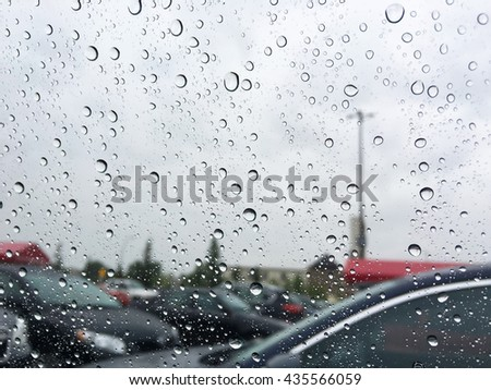 rain drops on car window - stock photo
