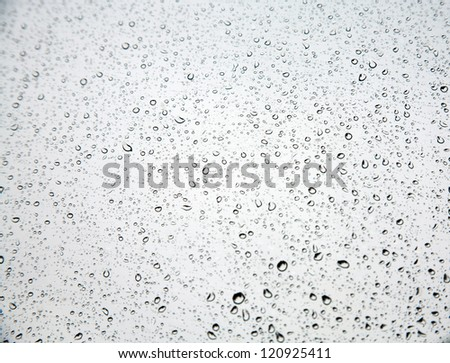 rain drops on clear window - stock photo