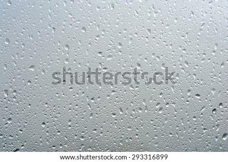 rain drops on clear window - stock photo