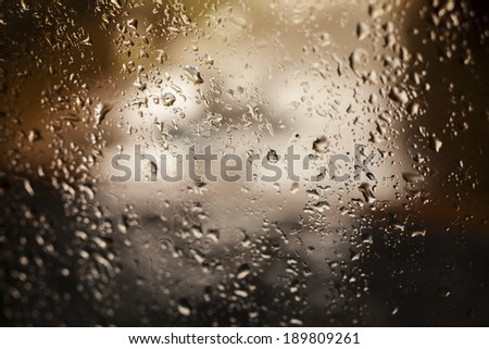 rain drops on glass with a  beautiful background - stock photo