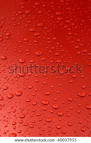 rain drops on orange car body, shallow focus - stock photo