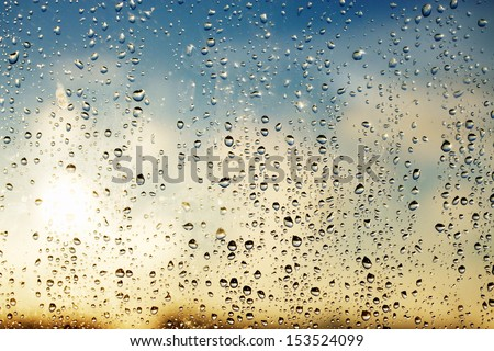 Rain drops on the glass during  - stock photo