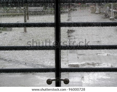 Rain drops on the glass panels - stock photo
