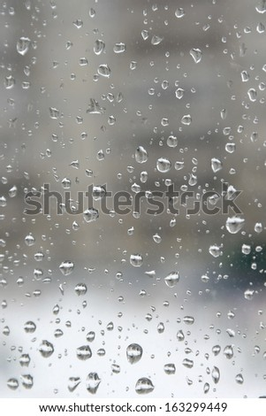 Rain drops on the window. Abstract background. Shallow DOF. - stock photo