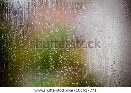 Rain drops on the window glass - stock photo