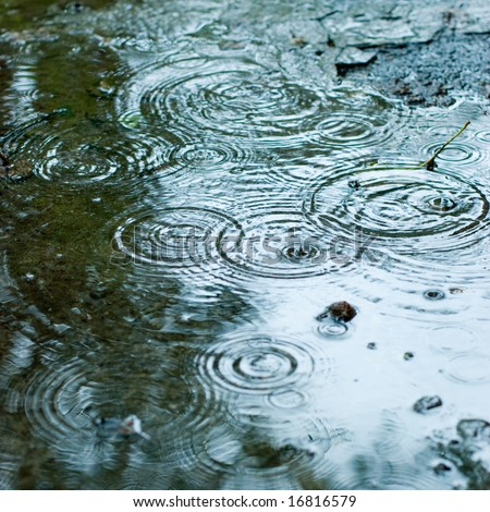 Rain drops rippling background - stock photo