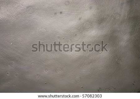 rain drops rippling background - stock photo