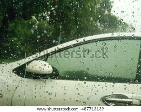 rain drops with white car background