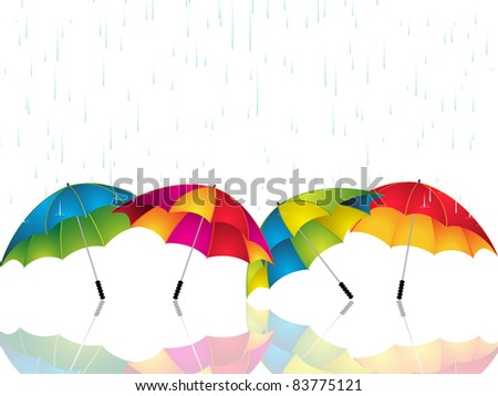 Rain falling on colorful umbrellas reflected on a white surface