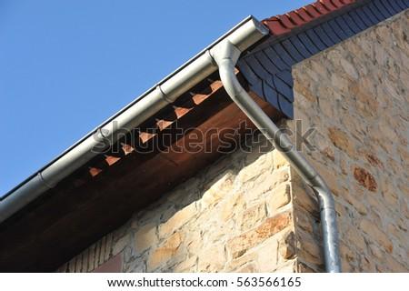 Elegant Rain Gutter, Rainwater Pipe On A Tiled Roof