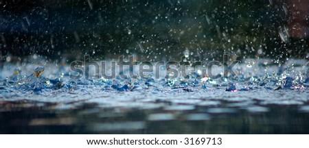 Rain in a swimming pool. - stock photo