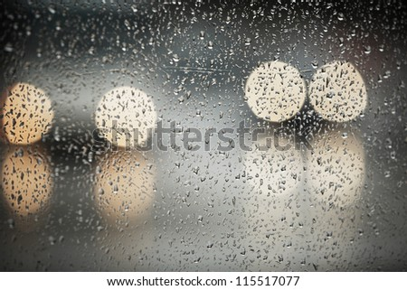 Rain in the city - selective focus on the raindrop