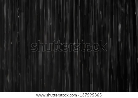 Rain on black. Abstract background. - stock photo