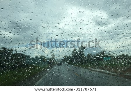 Rain on dashboard view from window car  - stock photo