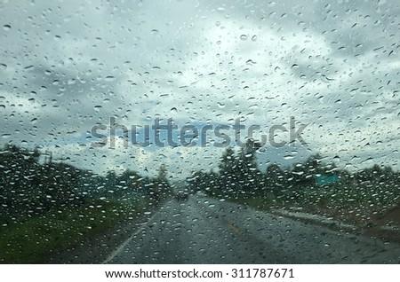 Rain on dashboard view from window car  - stock photo