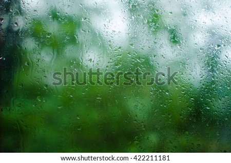 rain on glass/rain on window/drop of water on glass - stock photo