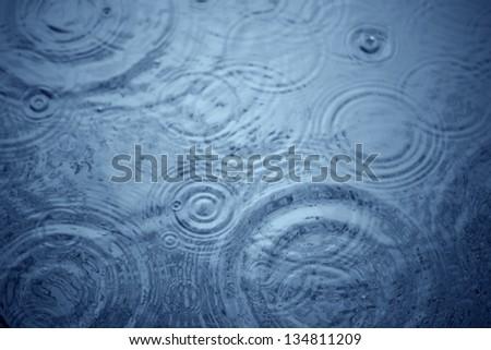 rain on lake - stock photo