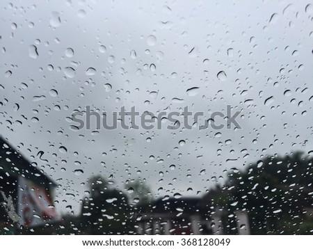 Rain on mirror. Dark tone, in Thailand. - stock photo