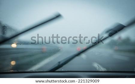 rain on the car windshield. focus on rain drops - stock photo