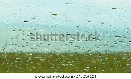 Rain on the window looking out to sea - stock photo