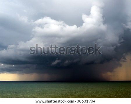 Rain over sea. - stock photo