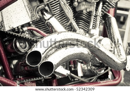 rain soaked red and chrome motorcycle abstract: 3 of 3 - stock photo