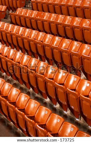 Rain-soaked seats at the Khalifa Tennis Stadium,  Qatar, during an interruption in an ATP match. - stock photo