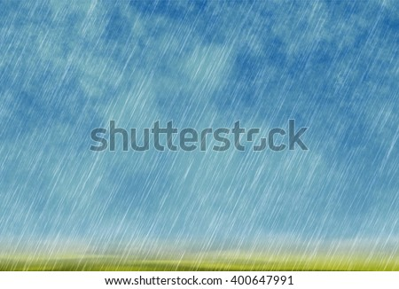 rain storm background in cloudy weather with green grass - stock photo