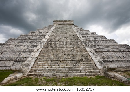 Rain storm over main temple at Chichen Itza one of the new seven wonders of the world - stock photo