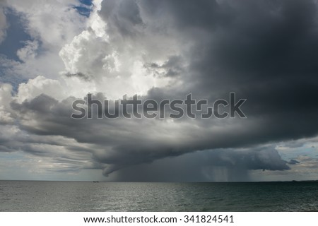 Rain storms are happening at sea. - stock photo