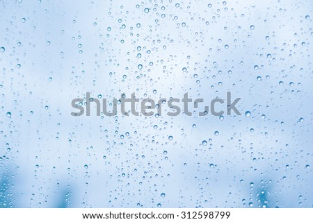 Rain water drops on a glass surface background, Abstract Backdrop - stock photo