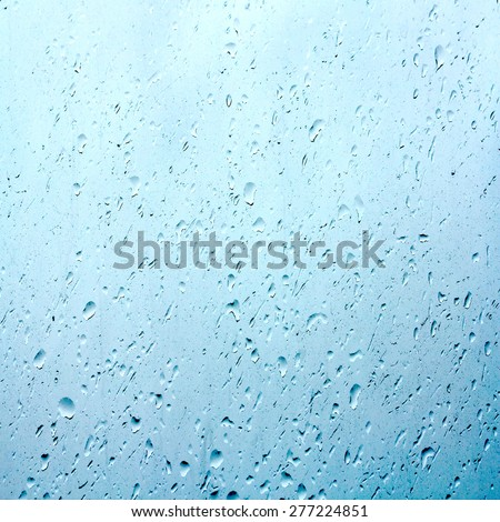 Rain water drops on glass