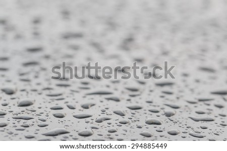 rain water on the gray car in close up background and textures - stock photo