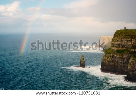 Rainbow above Cliffs of Moher and O'Brien's Tower. Ireland. - stock photo