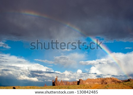 Rainbow after Summer storm at Monument Valley USA - stock photo