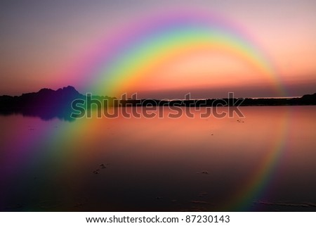 Rainbow an seascape - stock photo