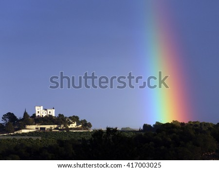 Rainbow and Castillo de Montemar on the Costa Blanca in southern Spain. - stock photo