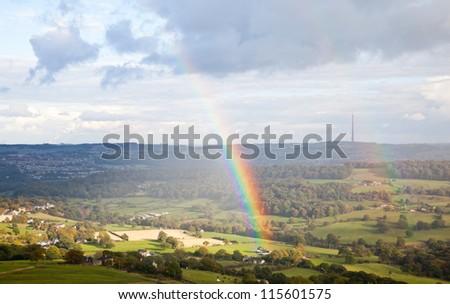 Rainbow and Emley Moor Television mast in west Yokshire, England, UK - stock photo