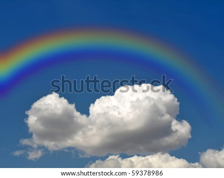 rainbow and white fluffy cloud on a background of the dark blue sky - stock photo