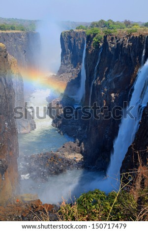 Rainbow at Victoria Falls, Africa - stock photo