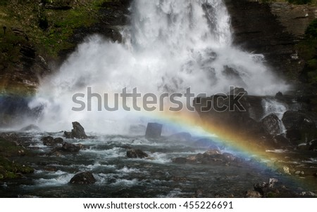 Rainbow behind famous Steinsdalsfossen waterfall in Norway