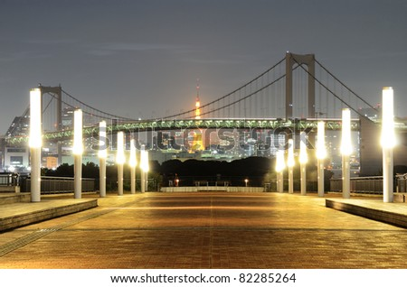 Rainbow Bridge in Tokyo without it's signature lighting due to energy conservation efforts in the wake of the Nuclear crisis. - stock photo