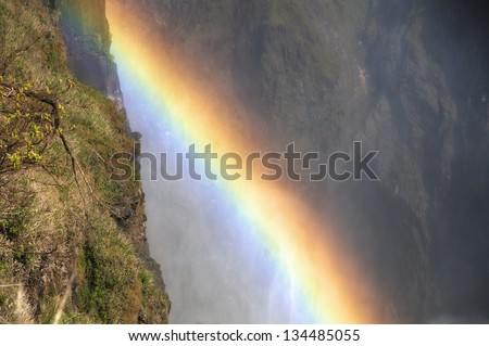 Rainbow by Victoria Falls in Zimbabwe, Africa - stock photo
